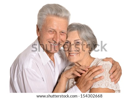 Happy older pair on a white background - stock photo