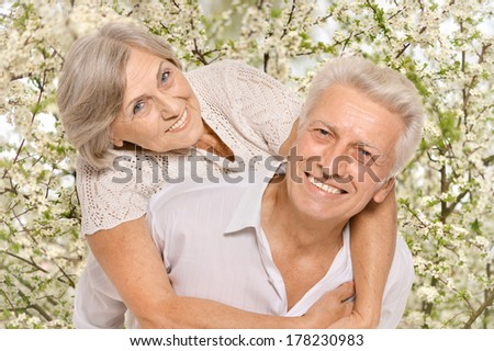Happy older pair on a white background