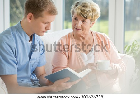 Happy older woman spending time with young man - stock photo