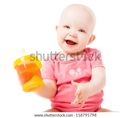 happy one year old baby drinking juice, isolated against white background - stock photo