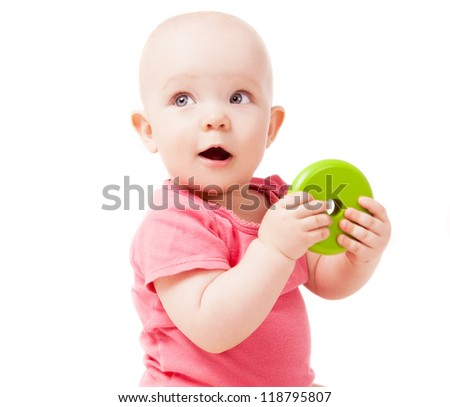 happy one year old baby playing with a toy, isolated against white background