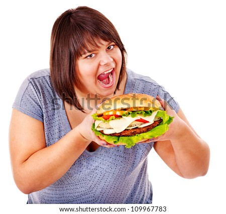 Happy overweight woman eating hamburger. Isolated.