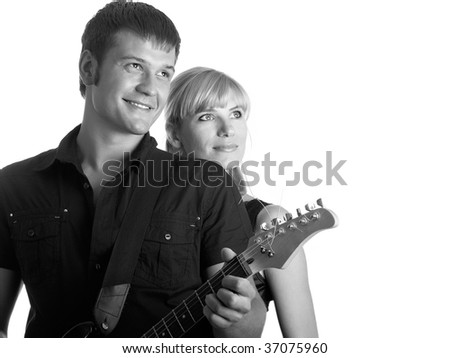 Happy pair - the guy with a guitar - stock photo
