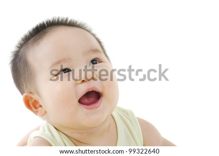 Happy pan Asian baby looking up and smiling - stock photo