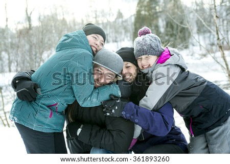 Happy parents and their kids in winterwear  - stock photo