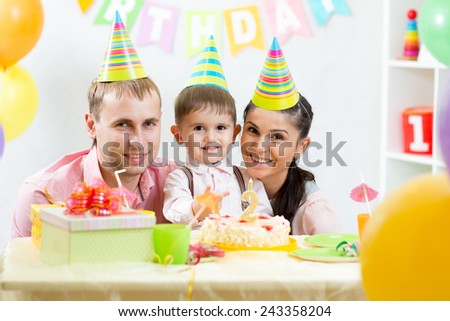 happy parents celebrating 2 years from birth day of kid