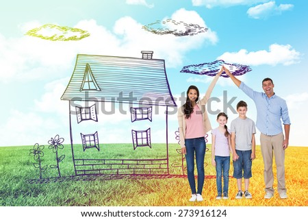 Happy parents joining hands above children against blue sky over green field - stock photo