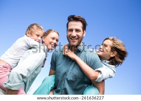 Happy parents with their children in the countryside