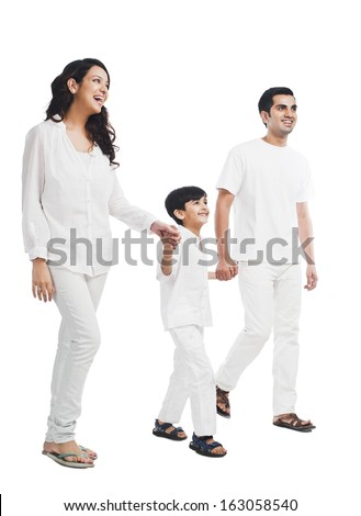 Happy parents with their son holding hands - stock photo