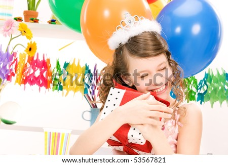 happy party girl with balloons and gift box - stock photo