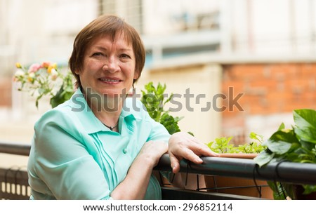 Happy pensioner woman relaxed on teracce and smiling