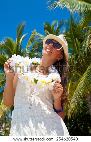 Happy people. Beautiful woman with welcoming Lei cheerful, happiness during summer vacation holidays on Hawaii. Luxury vacation - stock photo