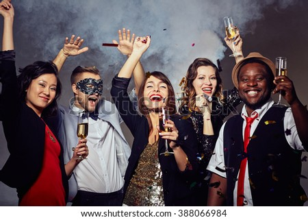 Happy people celebrating the holiday with champagne - stock photo