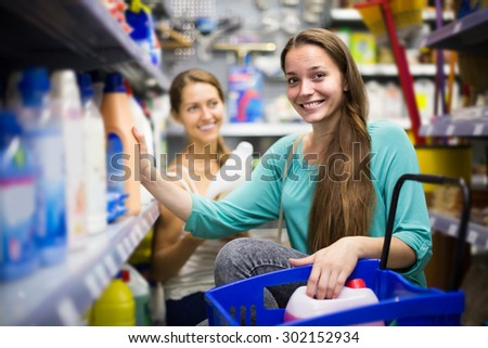 happy  people choose some detergents in the shop - stock photo
