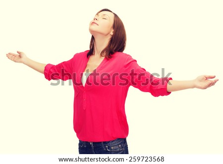 happy people concept - smiling woman waving hands with closed eyes - stock photo