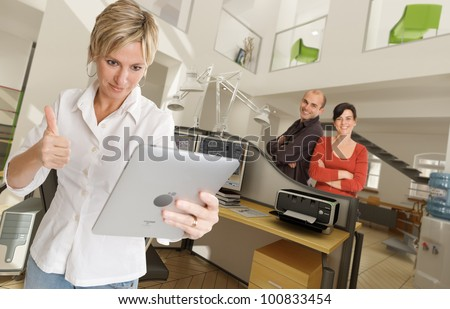 Happy people in a modern beautiful office - stock photo