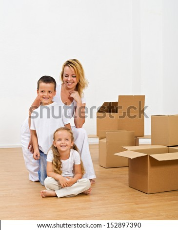 Happy people in a new home smiling on the floor - the excitement of novelty - stock photo