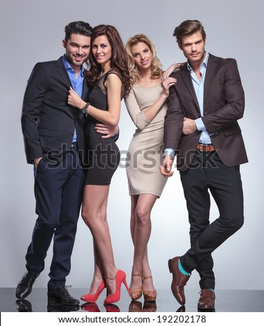 happy people in elegant clothes posing in studio - stock photo