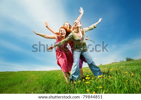 Happy people in field - stock photo