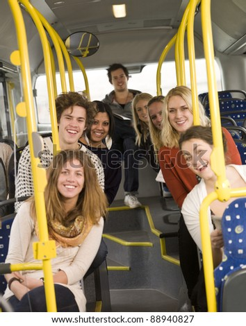 Happy people on the bus - stock photo
