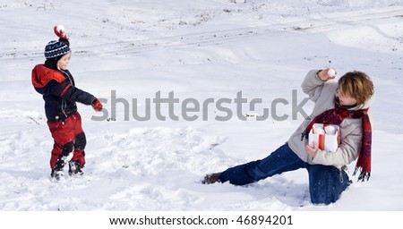 Happy people playing in the snow of winter - stock photo