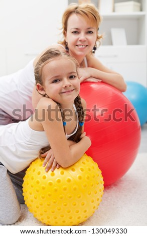 Happy people relaxing during gym exercises - smiling