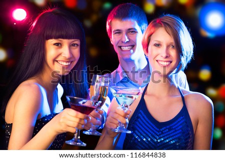 Happy people relaxing together at party - stock photo