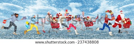 Happy people running with Christmas gifts. Holiday background. - stock photo