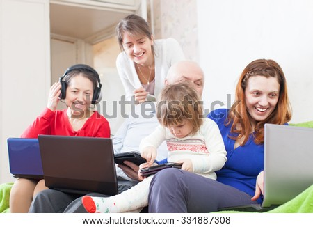 happy people  uses few various  devices at home  - stock photo