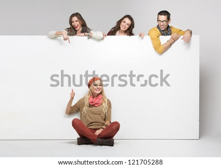 Happy people with big white board - stock photo