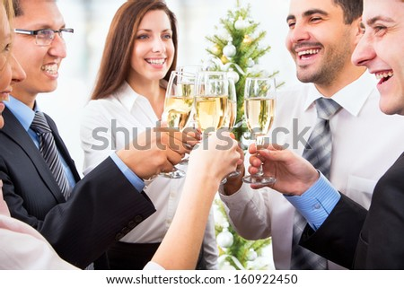 Happy people with of crystal glasses full of champagne