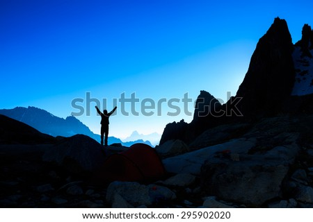 Happy person enjoying a new dawn in the mountains.  - stock photo