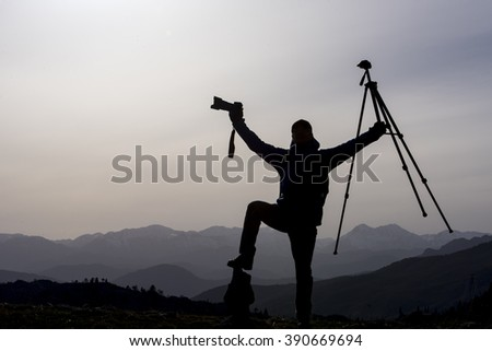 happy photographer in mountains