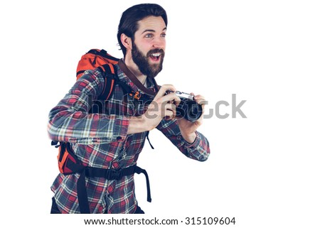 Happy photographer taking picture against white background