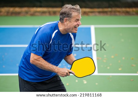Happy Pickleball Player - stock photo
