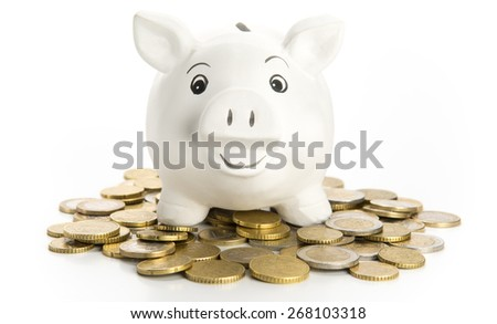 Happy piggy bank on coins, isolated on white - stock photo