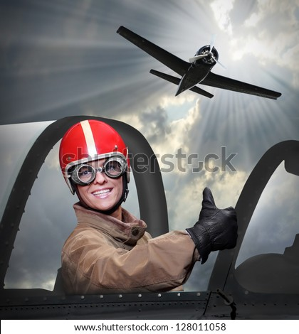 Happy pilot in a cockpit of a vintage plane. - stock photo