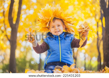 happy playful child outdoors in the autumn park