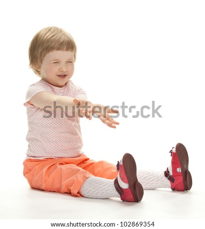 Happy playful child ready to catch something; white background