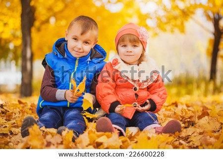 happy playful children outdoors in the autumn park