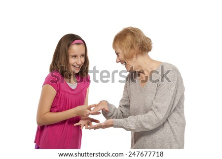 Happy playful granddaughter and grandmother isolated on white background - stock photo