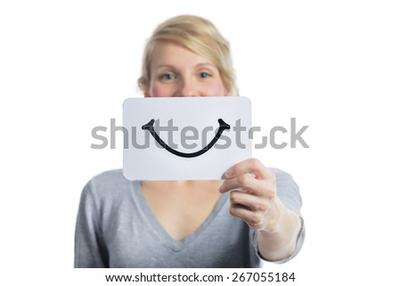 Happy Portrait of a Woman Holding a Smiling Mood Board Isolated on White Background - stock photo
