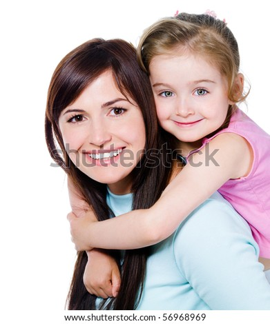 Happy portrait of beautiful young mother with little pretty daughter - isolated on white