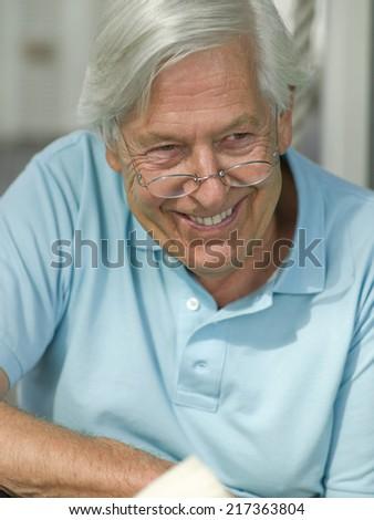 Happy portrait of senior man - stock photo