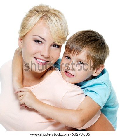 Happy portrait of the mother and son of six years. Isolated on white - stock photo