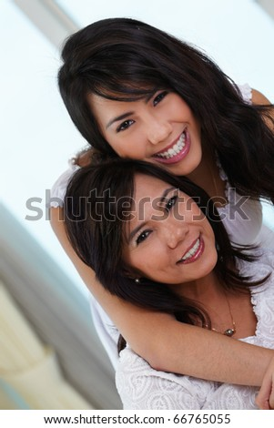 Happy pose of mother and daughter in their home. - stock photo