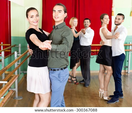 Happy positive adults  enjoying of classical dance in class - stock photo