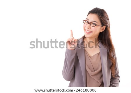 happy, positive female business executive, business woman pointing one finger up, white isolated background - stock photo