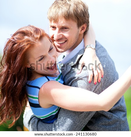 Happy positive romantic loving couple is hugging and laughing - stock photo