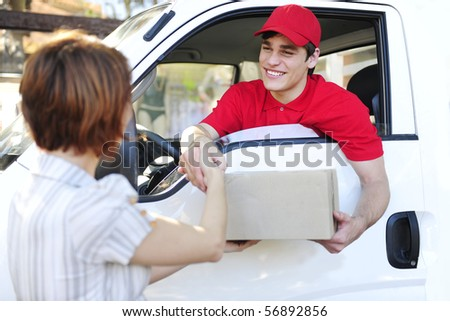 happy postal delivery courier in a van delivering package and handshake